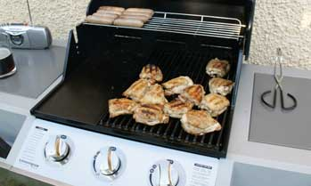 Chicken cooking on a gas barbecue